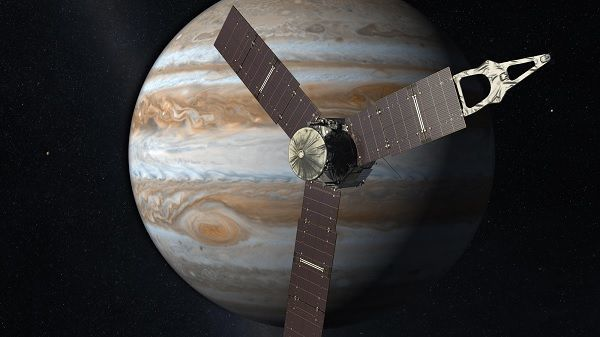 N.A.S.A. artist impression of Juno Probe in orbit round Jupiter